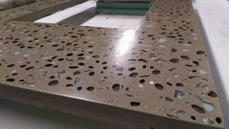 Gorgeous variety of colors and styles of glass and concrete to compliment the backsplash.
