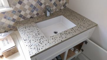 The Root Beer jelly beans, Clear Plate glass, Teal jagged glass, Coated mirror nuggets and the natural color of this special blend of Concrete,,, with that backsplash... Score!